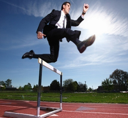Man jumping over hurdles